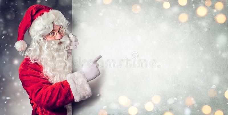 Santa Claus Pointing Blank Billboard. Wish List royalty free stock photography