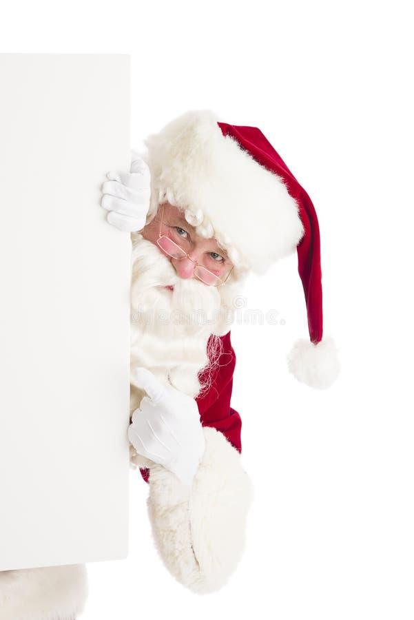 Santa Claus Pointing At Blank Sign fotografie stock libere da diritti