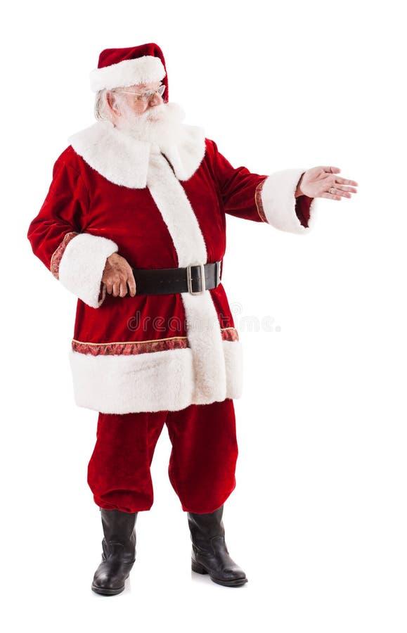 Santa Claus Points And Looks To Zijn Linkerzijde stock afbeeldingen