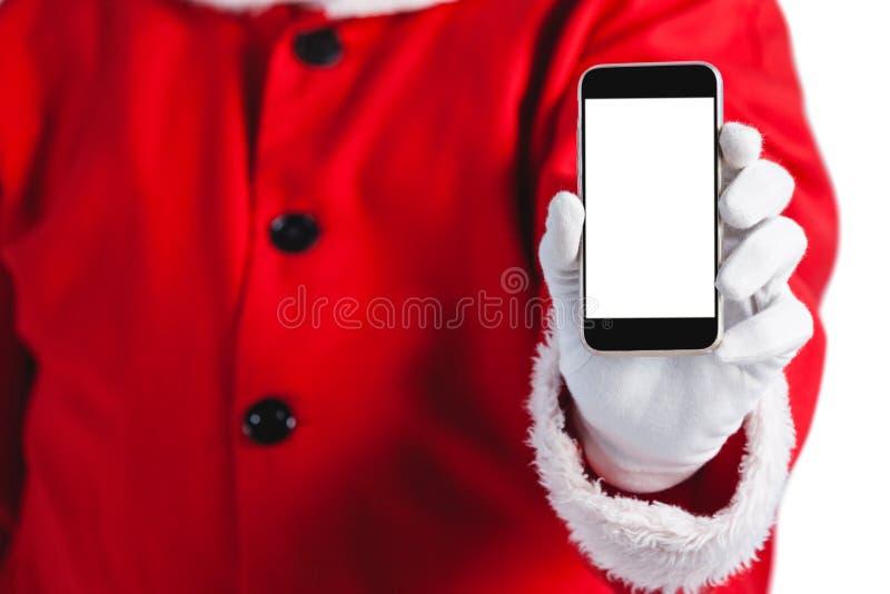 Santa Claus pokazuje telefon komórkowego przeciw białemu tłu zdjęcia stock