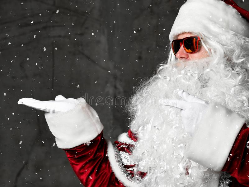 Santa Claus ponding hands at the corner for text copy space. New year and Merry Christmas stock photos
