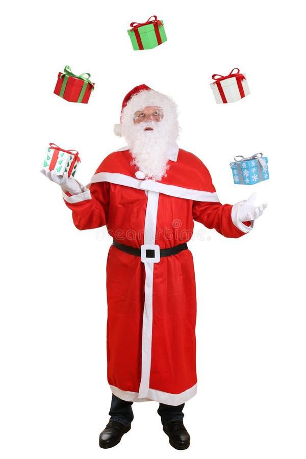 Santa Claus-Porträt werfende Weihnachtsgeschenke lokalisiert stockfotografie