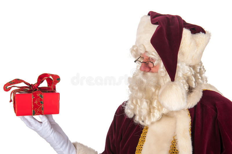 Santa Claus with present. Portrait of Santa Claus with present stock photography