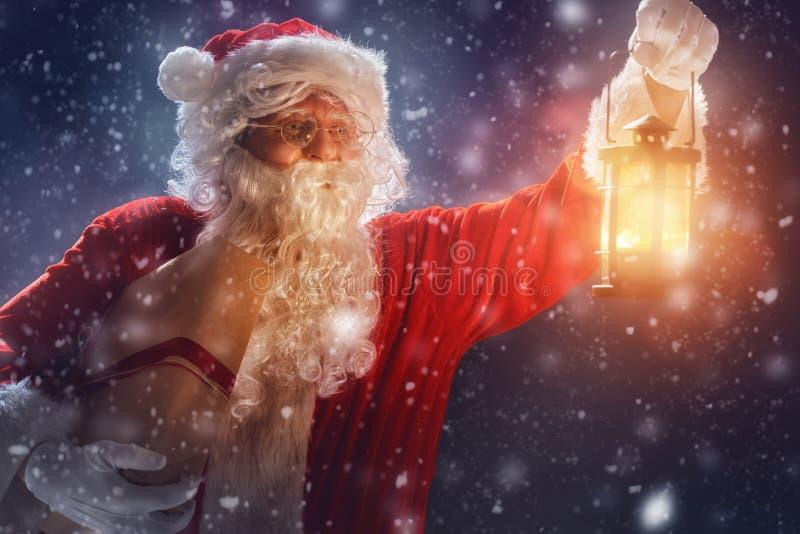 Santa Claus with present. royalty free stock photos