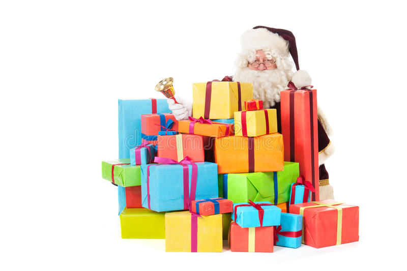 Santa Claus with presents. Portrait of Santa Claus with many presents an d copper bell stock photo