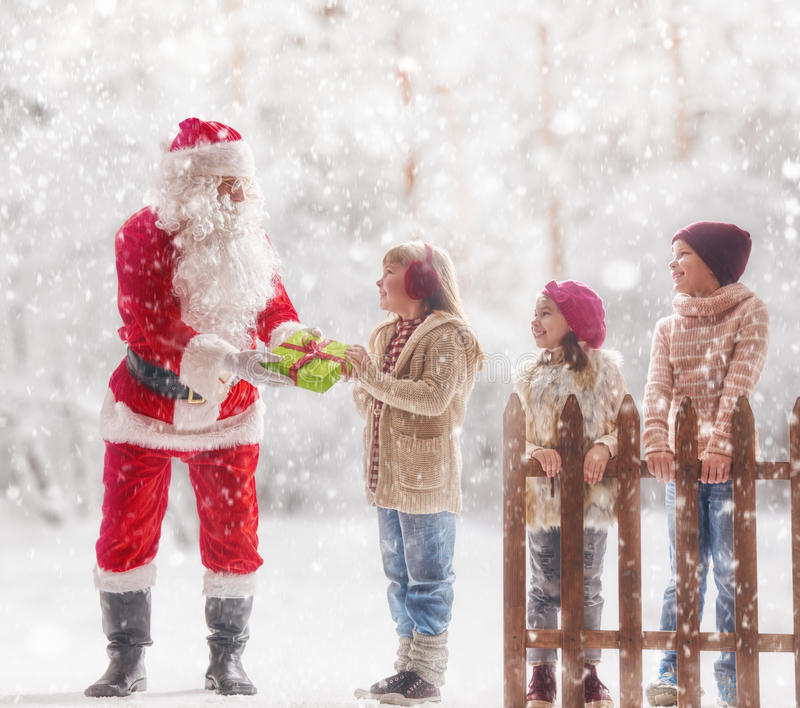 Santa Claus presents gifts royalty free stock photography