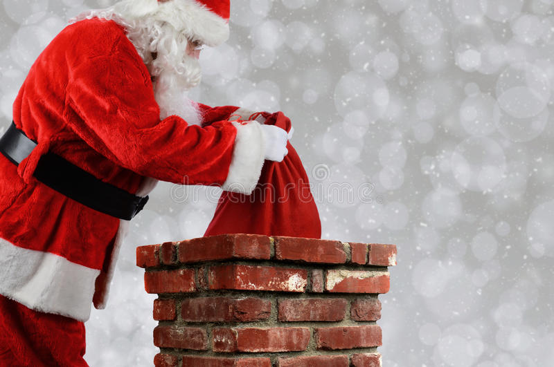 Download Santa Claus Putting Bag Into Chimney Stock Photo - Image of presents, beard: 96368288