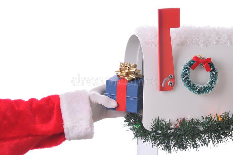 Santa Claus putting present in Mailbox stock photography