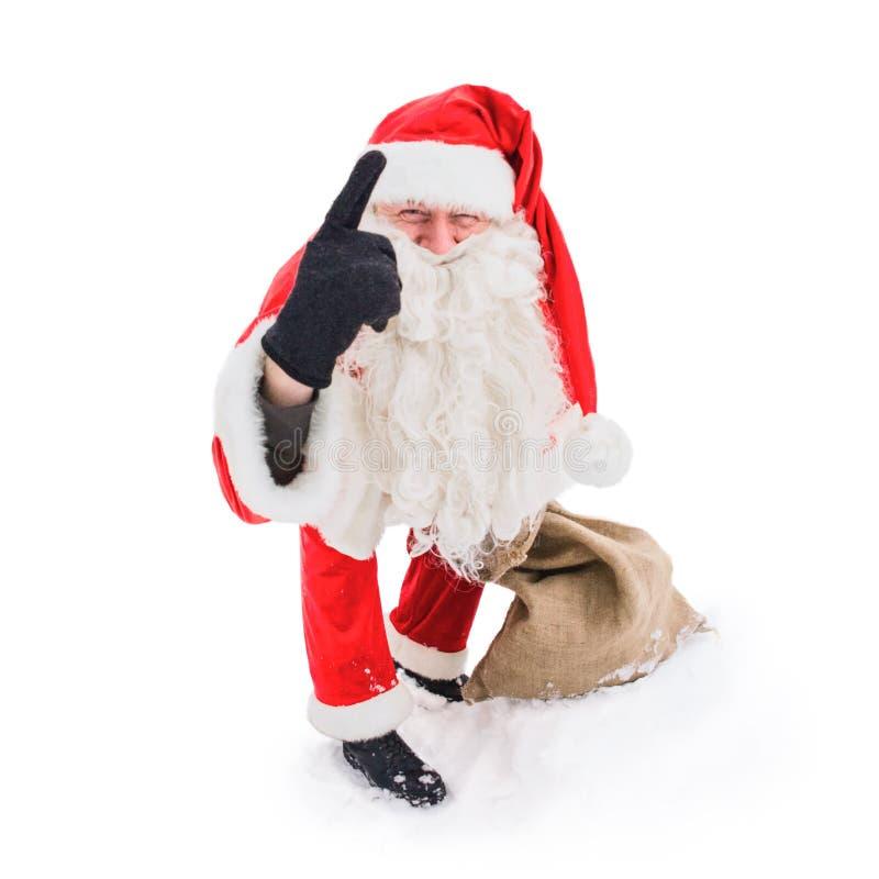 Santa Claus que aponta com seu indicador acima imagens de stock