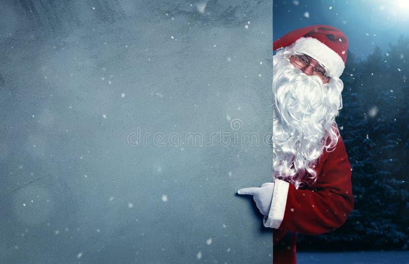 Santa Claus que aponta na bandeira imagens de stock royalty free