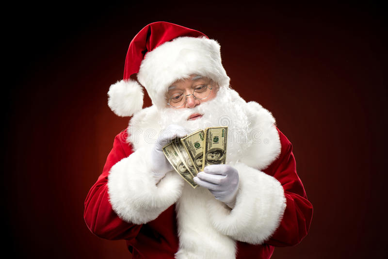 Santa Claus que conta cédulas do dólar fotos de stock royalty free
