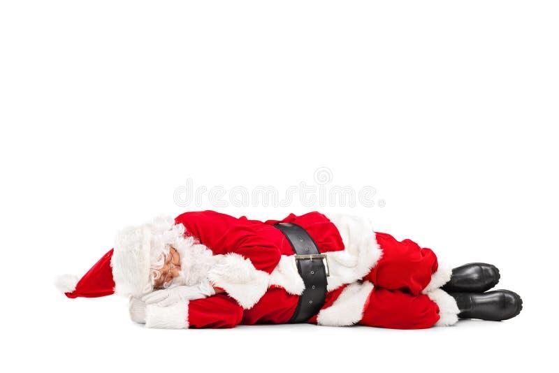 Santa Claus que dorme no assoalho fotografia de stock