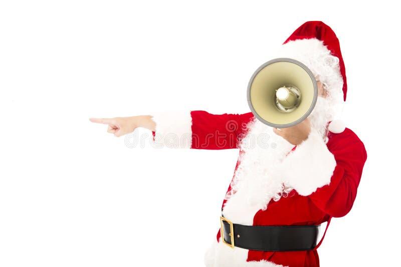 Santa Claus que guarda o megafone e que aponta o gesto imagem de stock royalty free