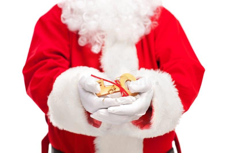 Santa Claus que guarda uma chave imagem de stock