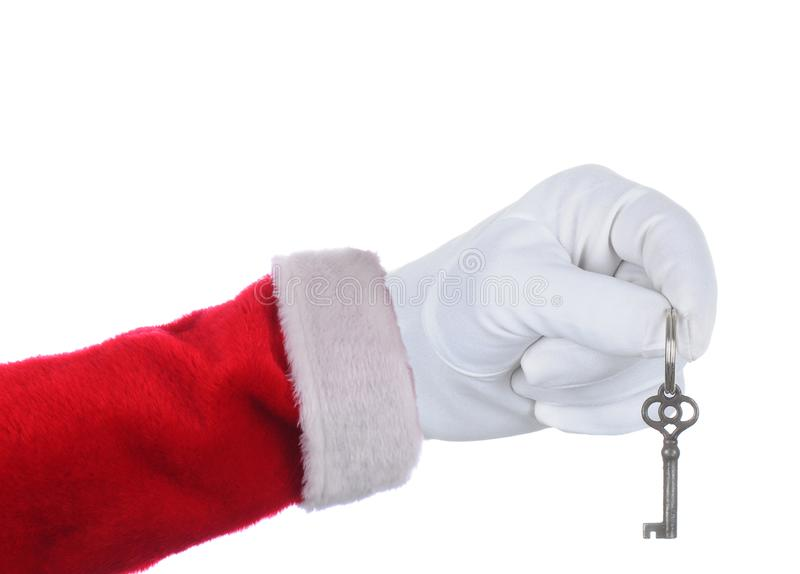 Santa Claus que guarda uma chave sobre um fundo branco foto de stock royalty free