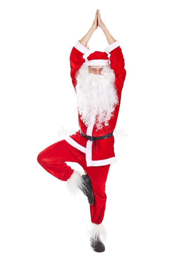 Santa Claus que hace ejercicio de la yoga fotos de archivo