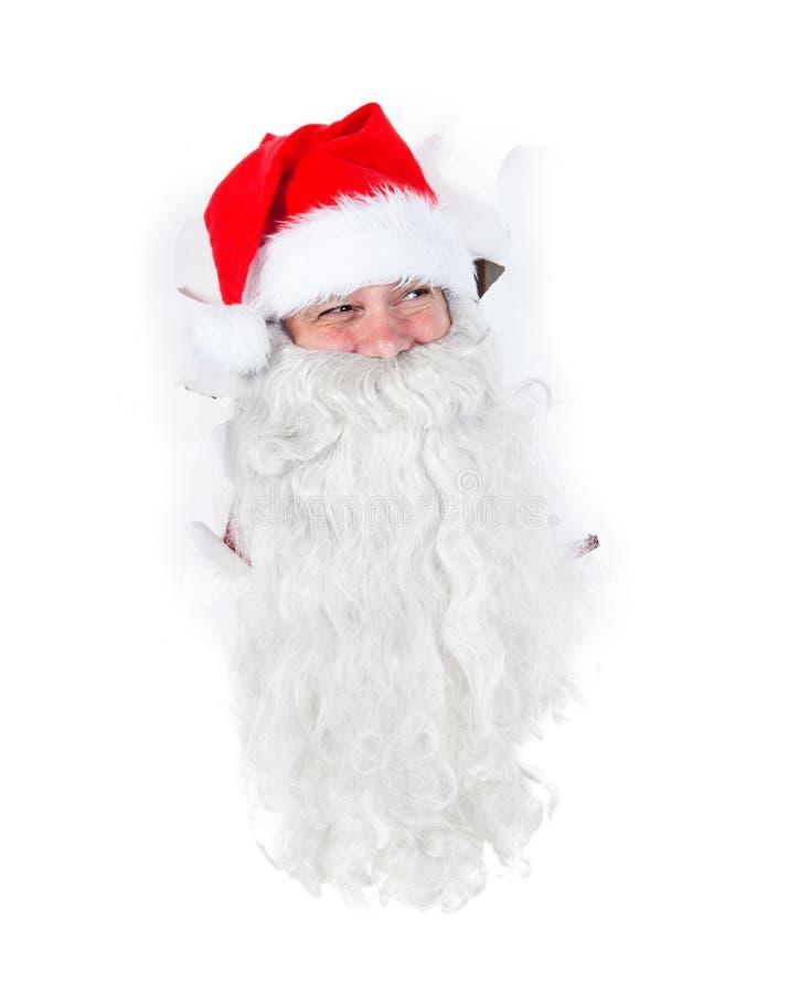 Santa Claus que olha através do furo imagens de stock