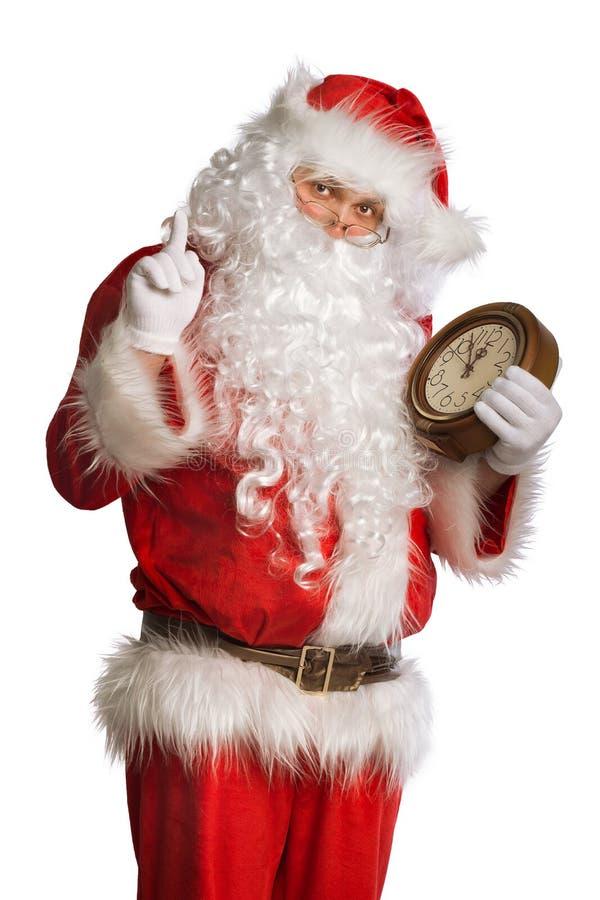 Santa Claus que sostiene un reloj imagen de archivo