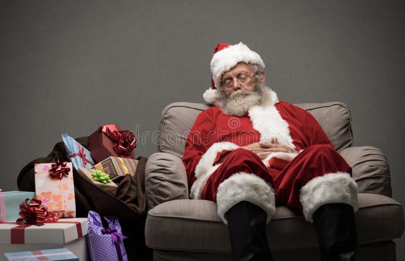 Santa Claus que toma uma sesta foto de stock royalty free