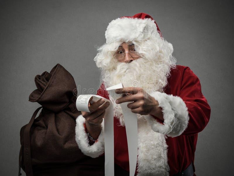 Santa Claus que verifica contas imagens de stock