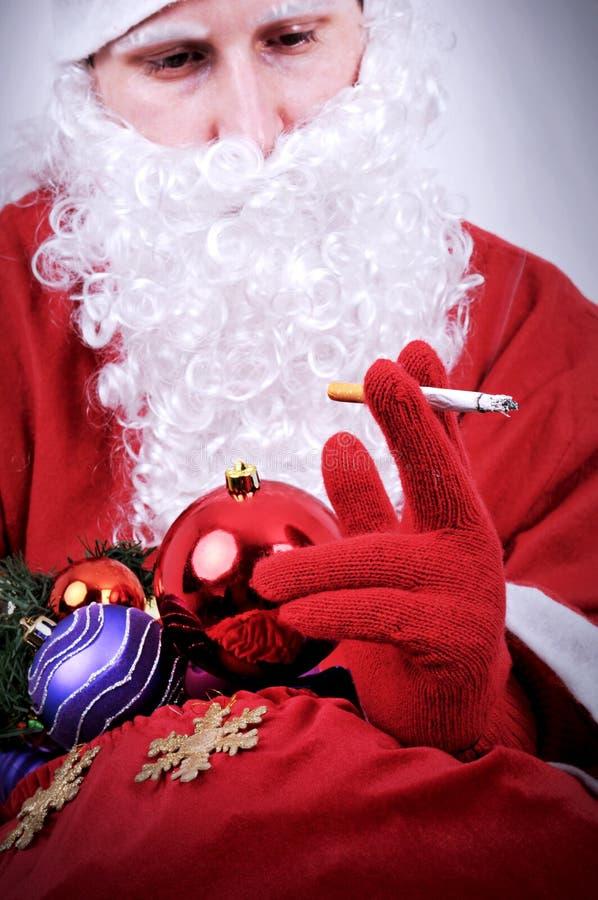 Santa Claus röka fotografering för bildbyråer