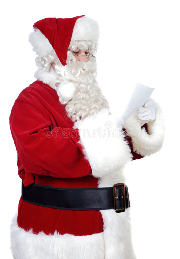Santa Claus reading a letter royalty free stock photo