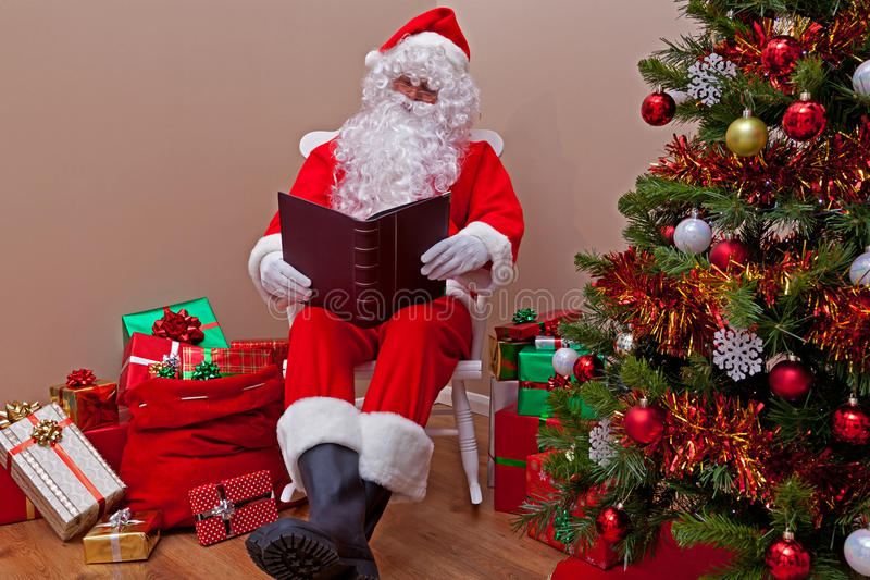 Santa Claus reading the list stock photos