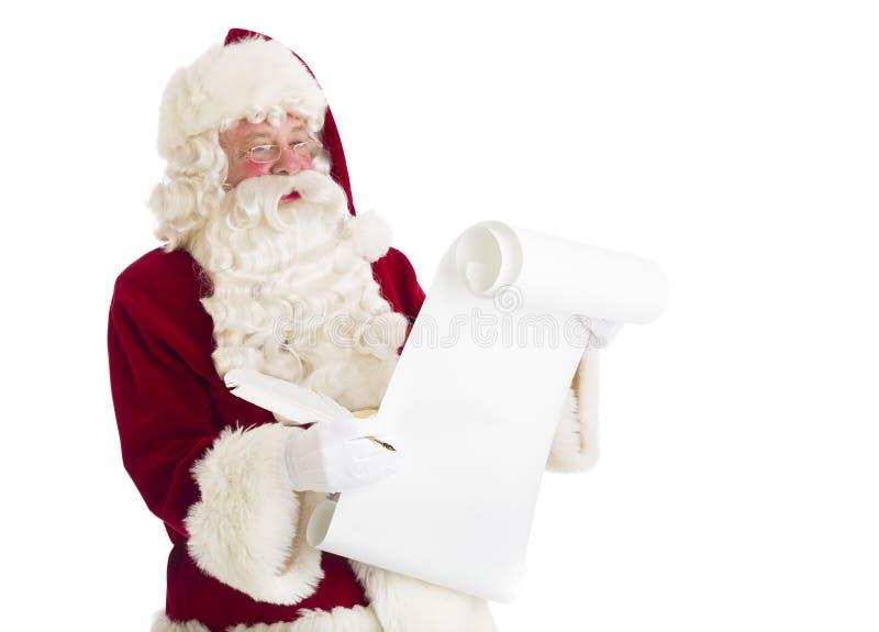 Santa Claus Reading List imagem de stock royalty free