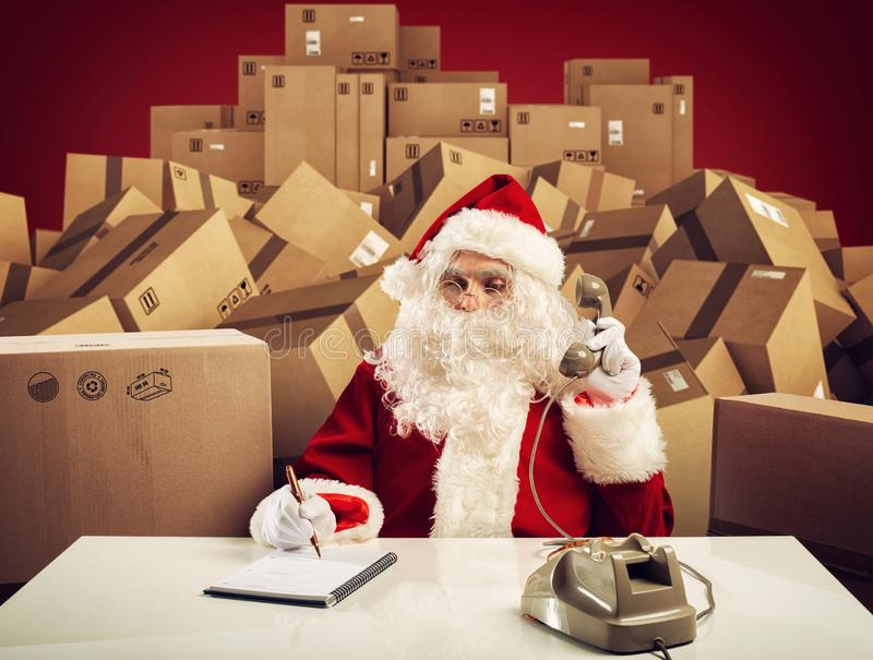 Santa Claus is ready to listen all order of gifts for Christmas stock photography