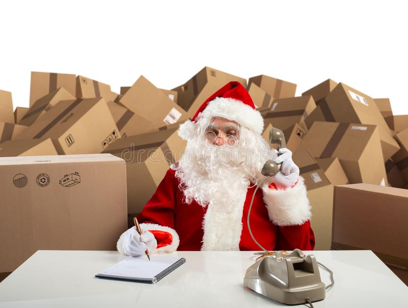 Santa Claus is ready to listen all order of gifts for Christmas. Eve royalty free stock photos