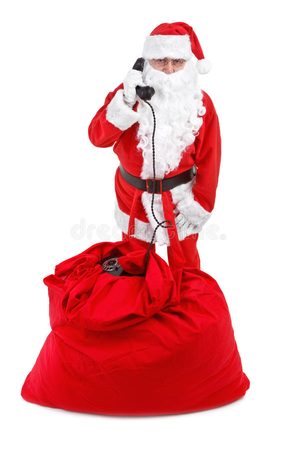 Santa claus receives a phone call. On white background stock photography