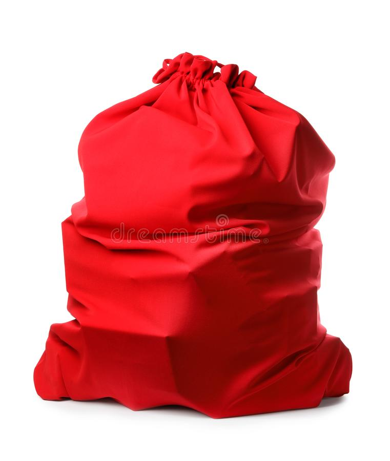 Santa Claus red bag full of presents isolated. On white royalty free stock image
