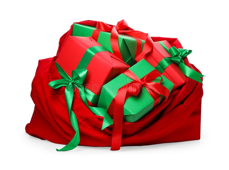 Santa Claus red bag full of presents on white. Santa Claus red bag full of presents isolated on white royalty free stock photo