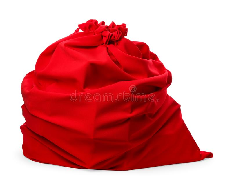 Santa Claus red bag full of presents on white. Santa Claus red bag full of presents isolated on white royalty free stock image