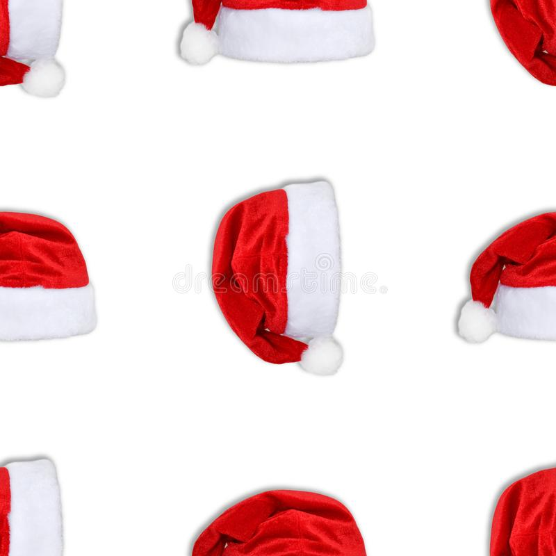 Santa Claus red hat isolated on white background. Red christmas hat or cap seamless pattern vector illustration