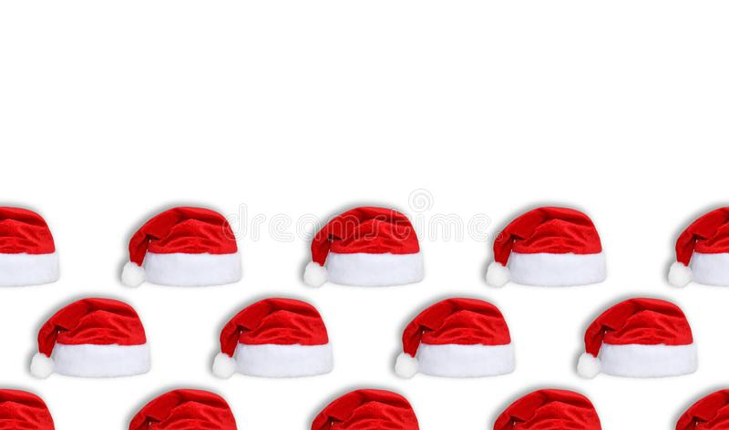 Santa Claus red hat isolated on white background. Red christmas hat or cap seamless new year pattern. Copy space. Long poster stock photo