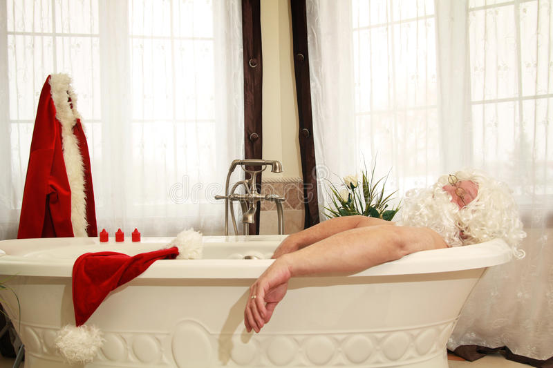 Santa Claus relax in bath. Santa claus is relaxing into a bath at home royalty free stock images