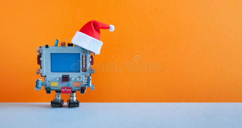 Santa Claus retro monitor computer toy on orange background. Funny Christmas New year greeting card mockup with personal stock photos
