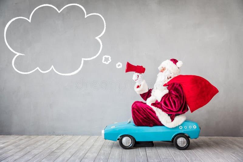Santa Claus Christmas Xmas Holiday Concept. Santa Claus riding car. Christmas Xmas holiday concept stock photo