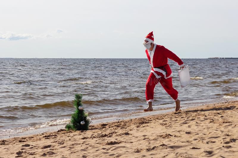 Santa claus is running with gifts  delivery   vacation christmas new year stock images