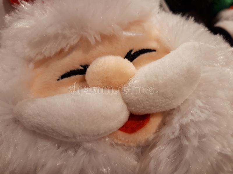 Santa Claus`s face - plush doll. Close up. Santa Claus`s face - plush doll royalty free stock photos