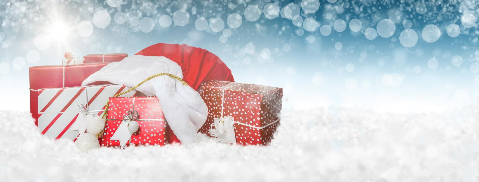 Santa Gift Bag in Snow Web Banner royalty free stock photos