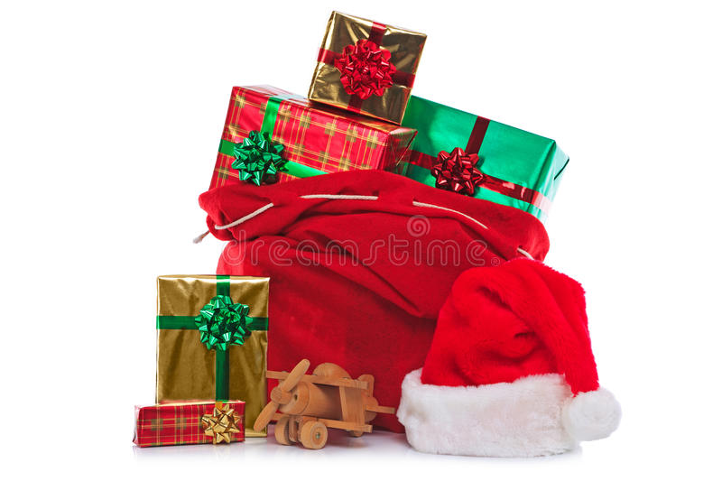 Santa Claus sack full of gift wrapped presents royalty free stock photos