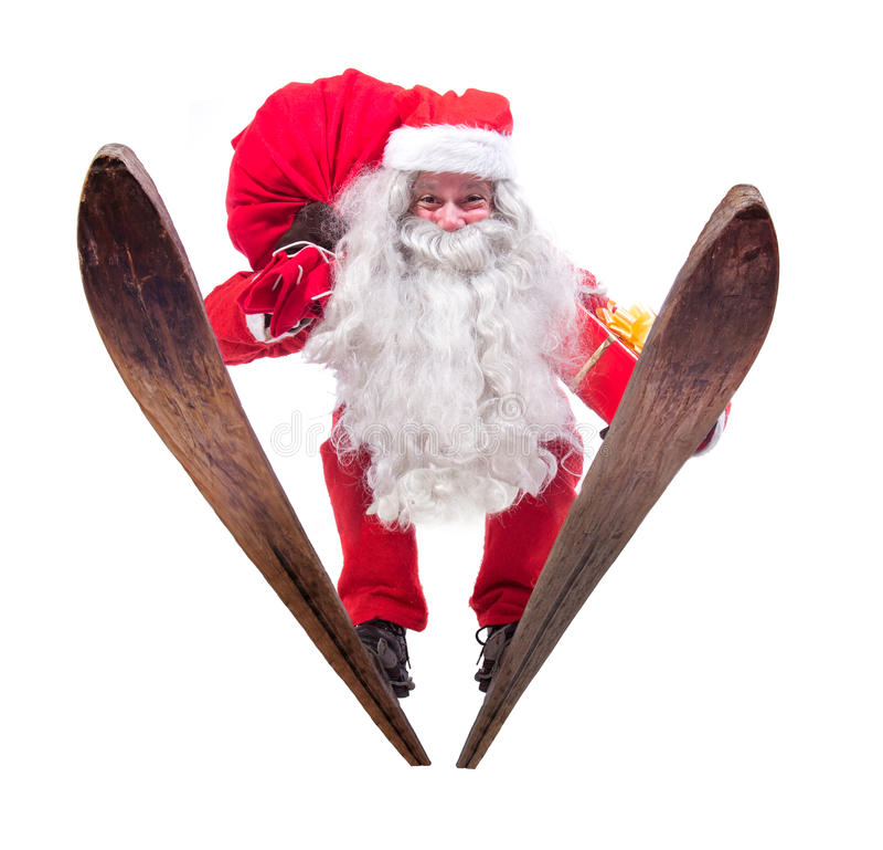 Santa Claus salta em esquis foto de stock