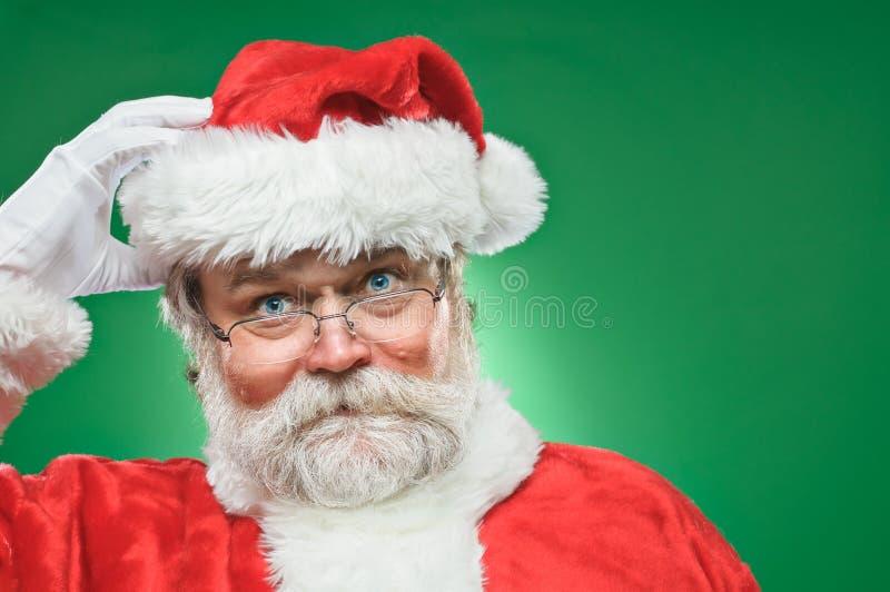 Santa Claus Scratching His Head confusa imagens de stock royalty free
