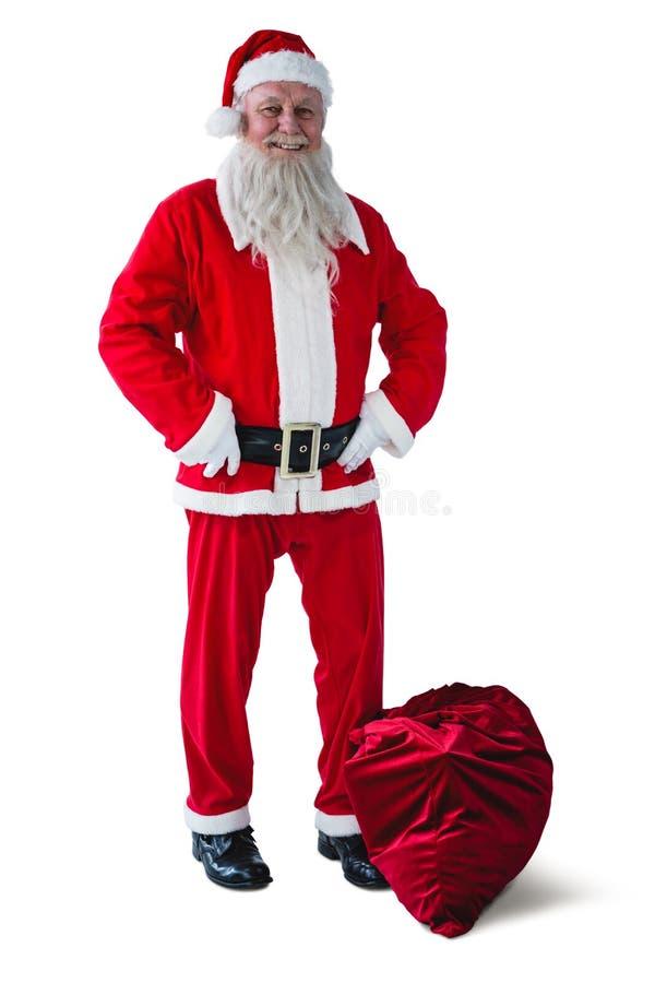 Santa Claus se tenant avec le sac de Noël photographie stock libre de droits