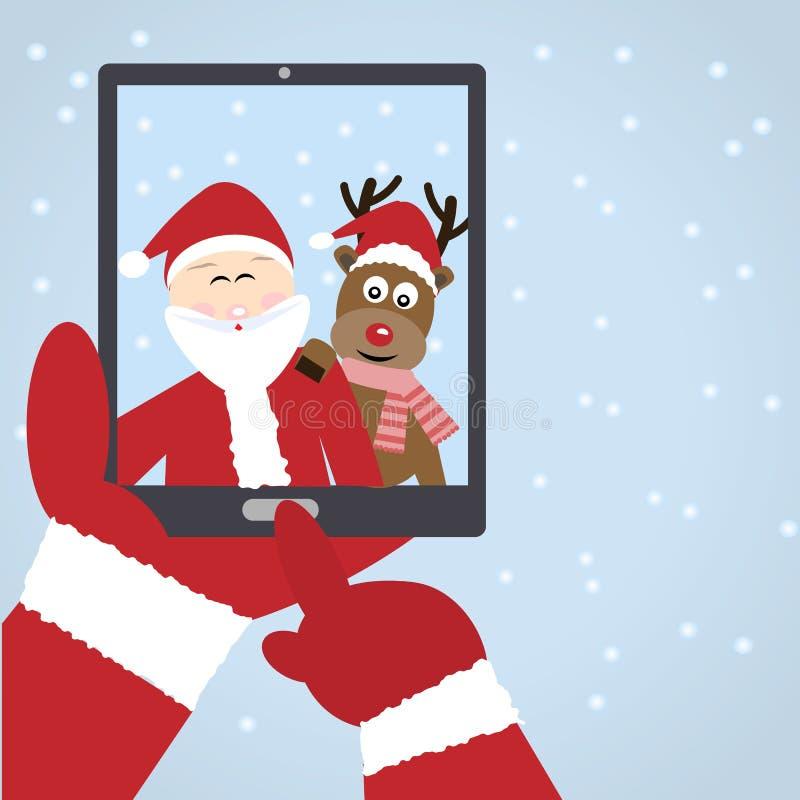 Santa Claus selfie with reindeer stock image