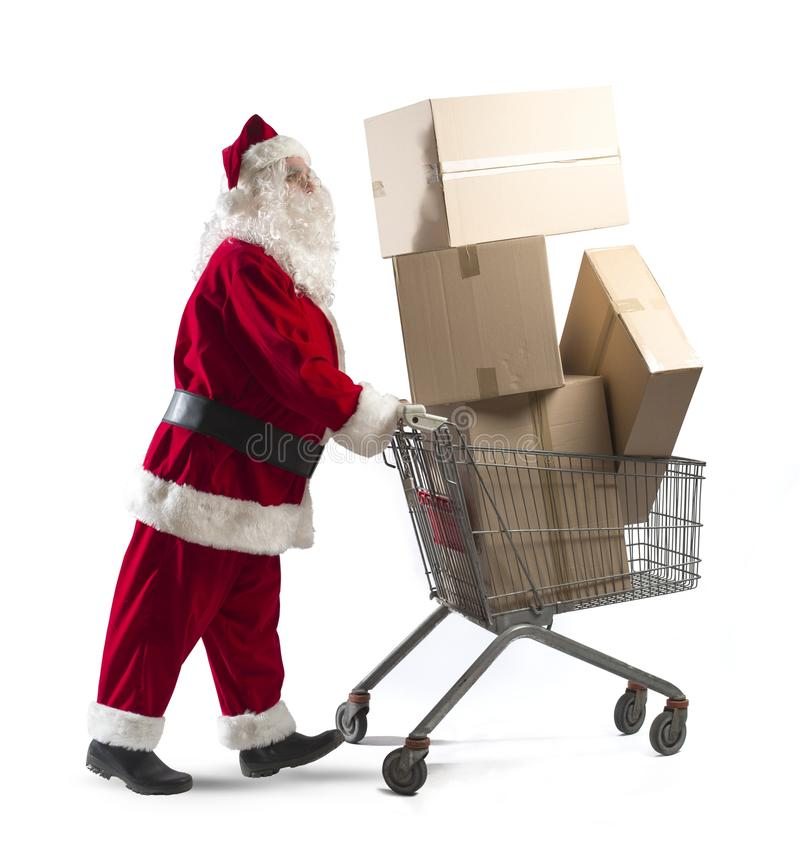 Santa Claus with shopping cart. Full of packages royalty free stock photography