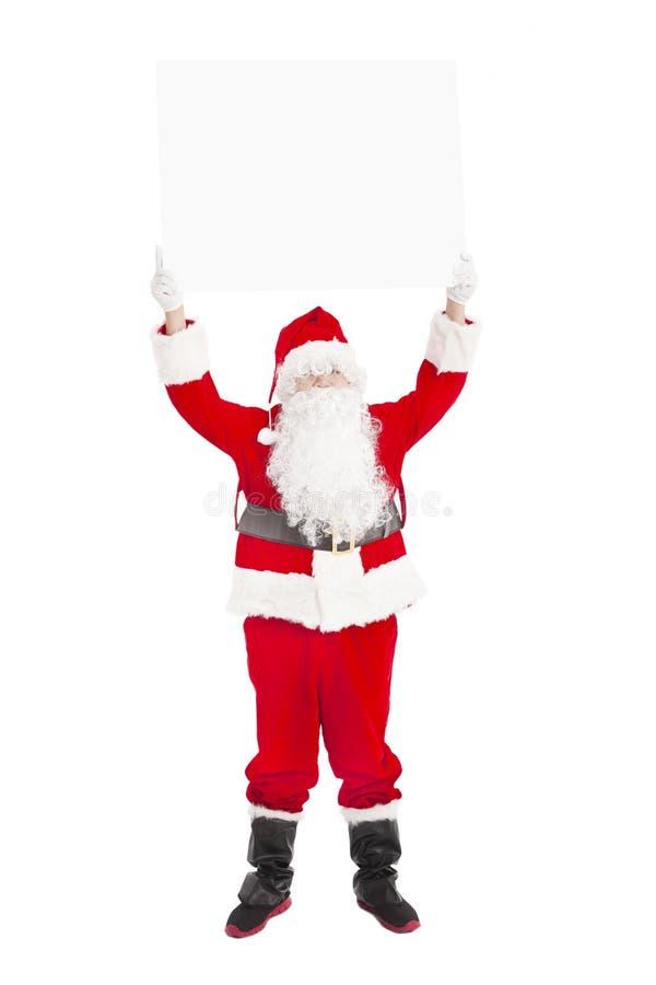 Santa Claus showing blank banner. Happy Santa Claus showing blank banner royalty free stock photos