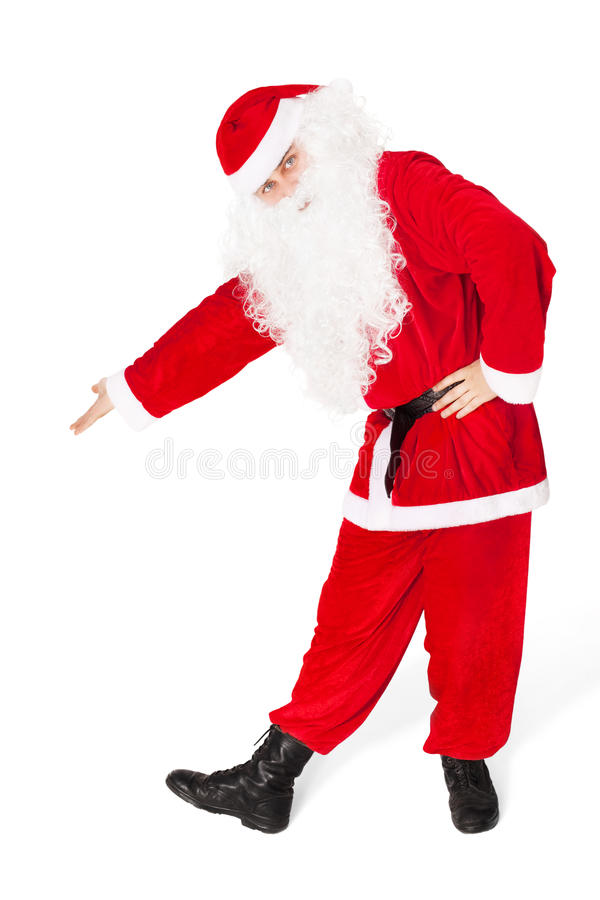 Santa Claus showing a copyspace isolated on white royalty free stock image